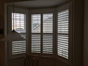 bi-fold sliding shutters